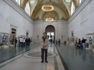 Jeff standing in the hall of armor in the Detroit Institute of Art